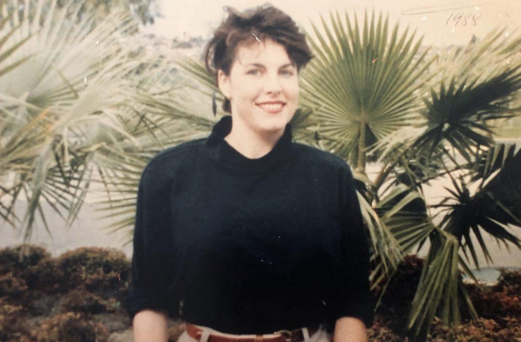Jacinta in 1988 sitting in a garden